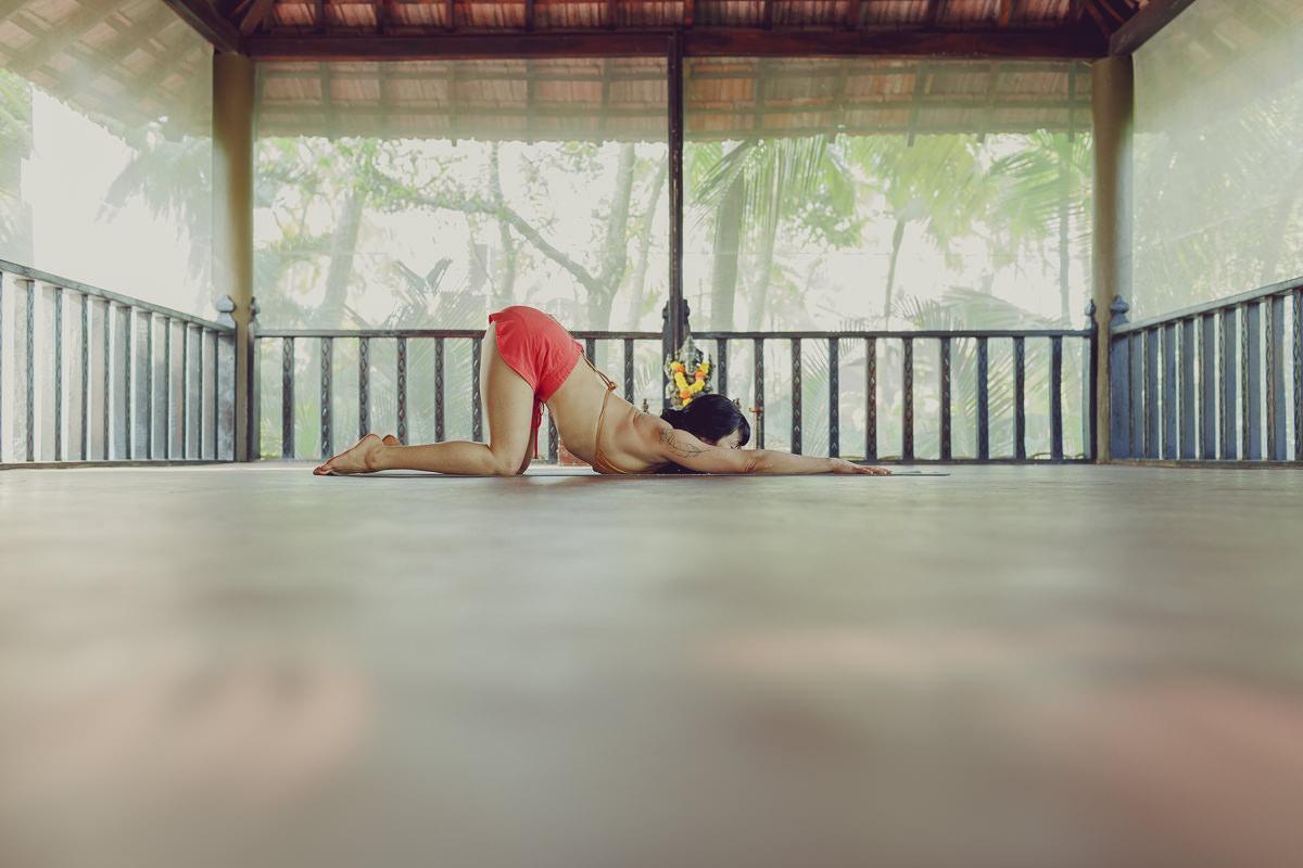 Yoga portrait of Meghan Currie striking a yoga pose in Goa