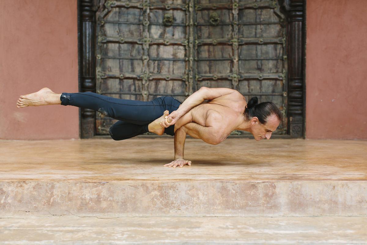 yoga picture of simon borg olivier striking an impressive yoga pose