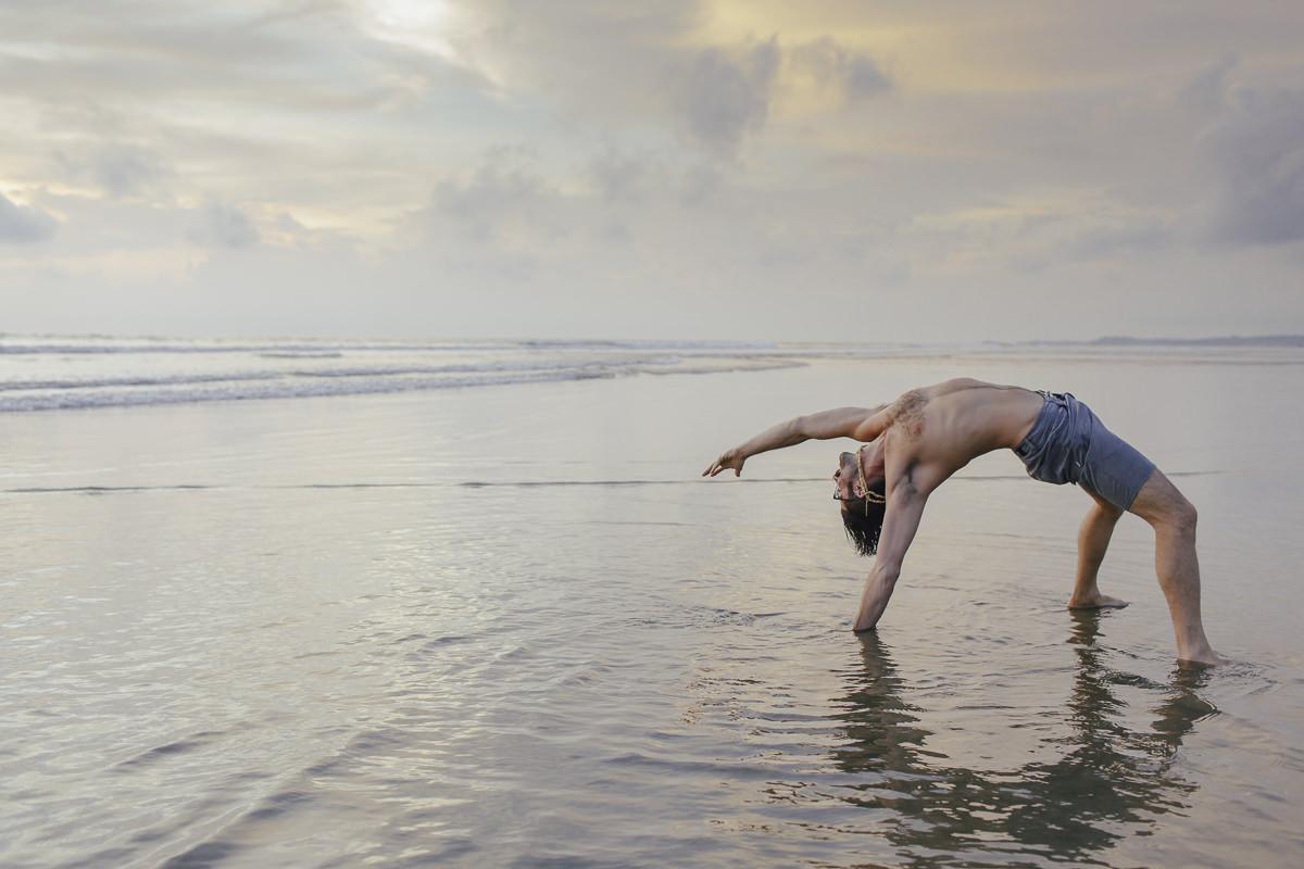 Yoga portrait of Daniel Scott at the beach