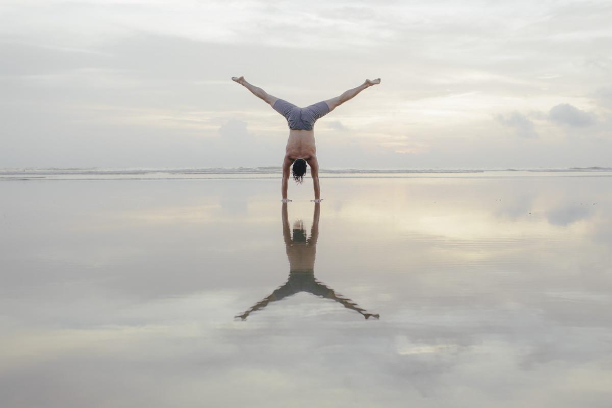 Beautiful Yoga portrait of yoga teacher Daniel Scott near the sea