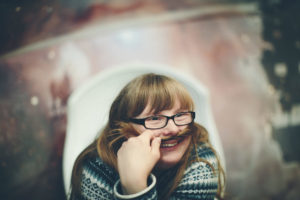 Portraitfoto einer jungen Frau mit Down Syndrom | Foto: Hanna Witte