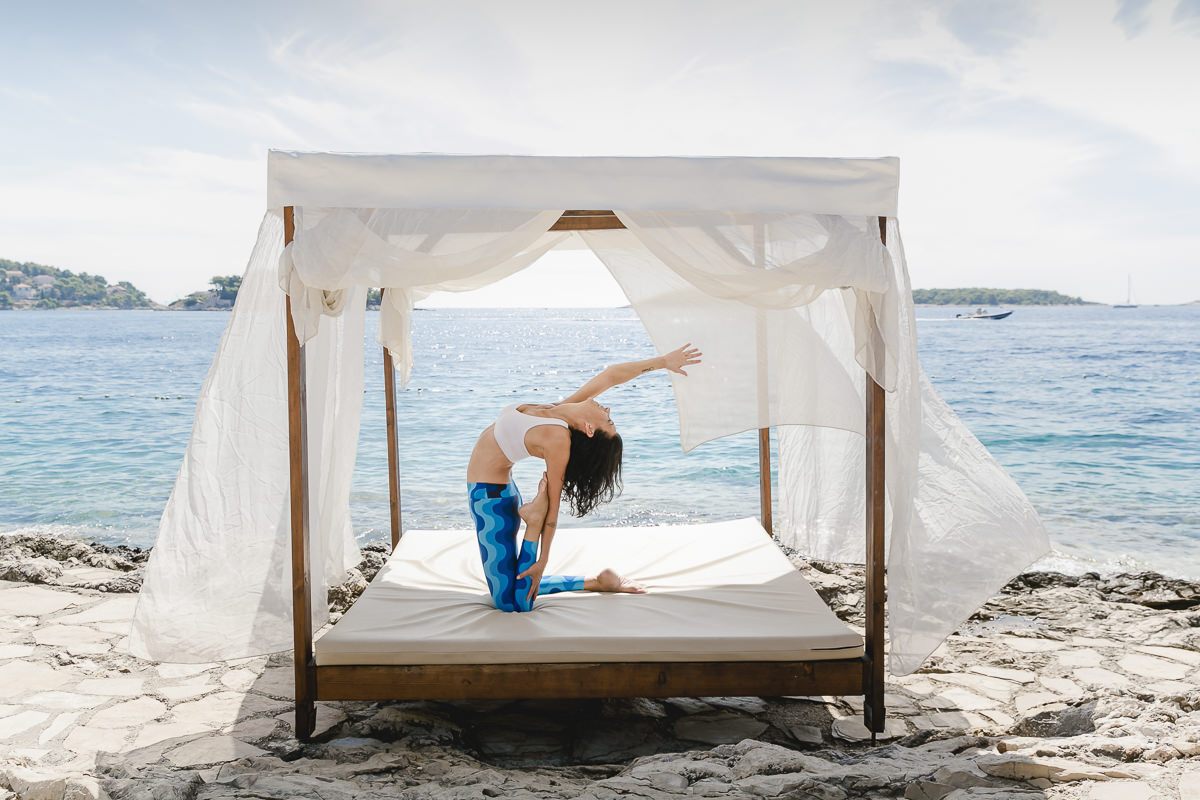 Yoga Portrait of Yoga teacher Andrea Sauter by the sea in Croatia