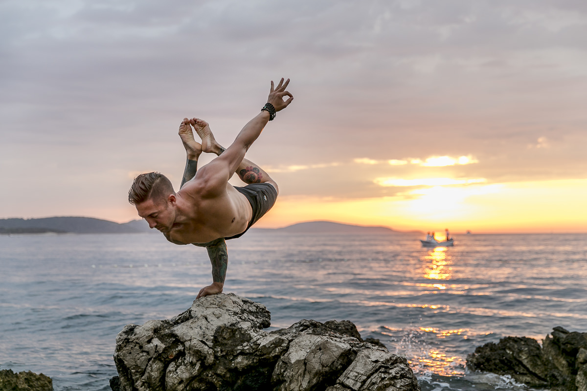 yoga portrait of yoga teacher dylan werner at sunset by the sea
