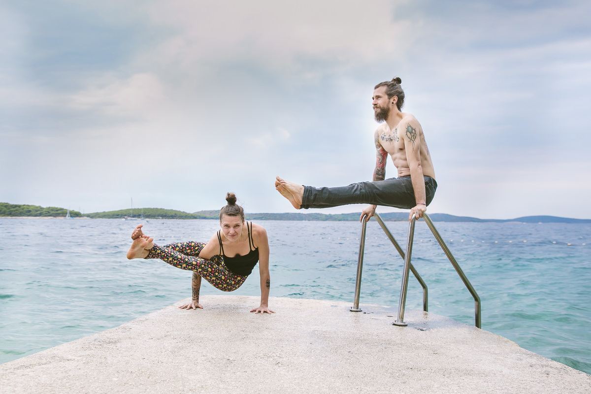 portrait photo of Liz Huntly and Roland Jensch practicing yoga by the sea