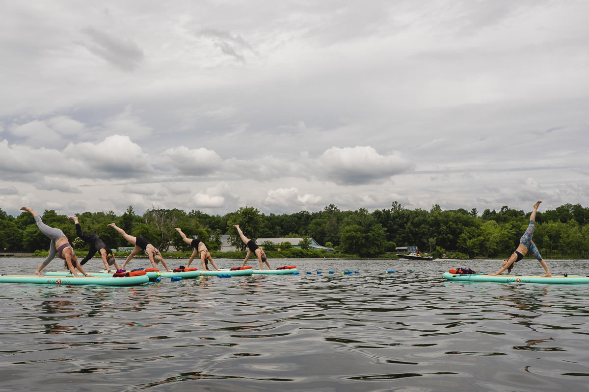 paddle board yoga class of Stéphanie Ouellette Rienks during the groove festival